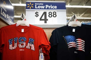 T-shirts made in the USA are on sale for $4.88 at the Walmart Supercenter in Bentonville, Arkansas June 5, 2014.  The Walmart Stores Inc. annual shareholder meeting takes place June 6, 2014.  REUTERS/Rick Wilking (UNITED STATES - Tags: BUSINESS) - RTR3SESG
